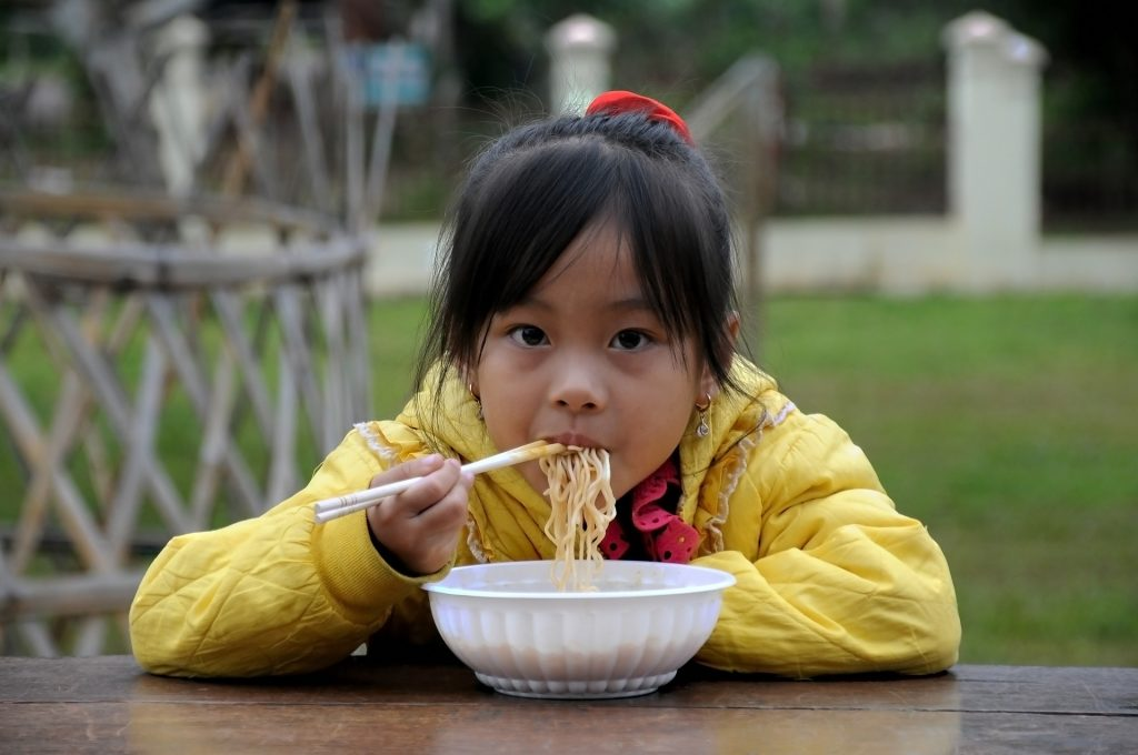 Kid with Noodles